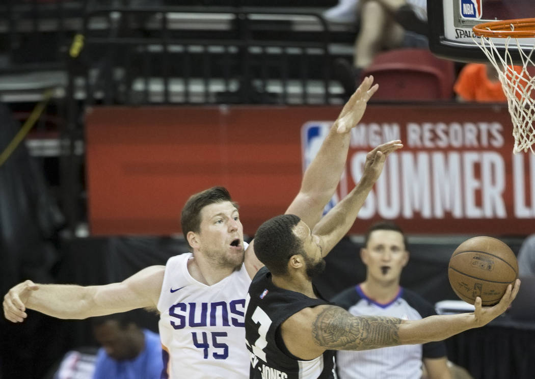 Phoenix Suns center Jack Cooley (45) attempts to block the shot of San Antonio Spurs guard Trey MvKinney-Jones (17) in the second quarter during theNBA Summer Leagueon Friday, July 13, ...