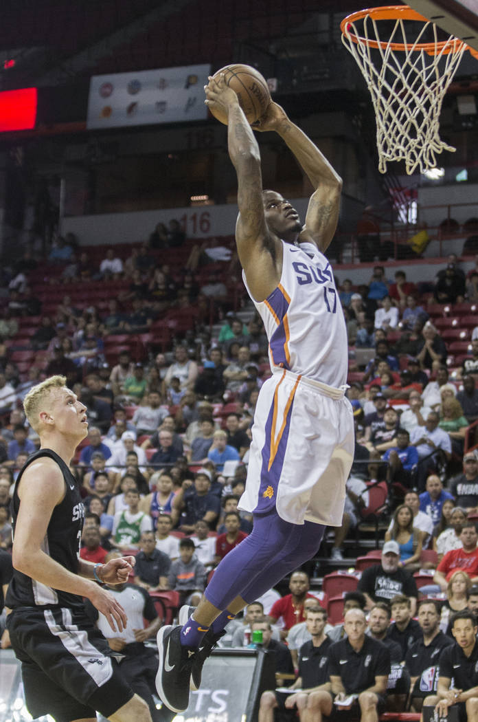 Phoenix Suns forward Javonte Green (17) dunks over San Antonio Spurs guard Maverick Rowan (31) in the second quarter during the NBA Summer League on Friday, July 13, 2018, at the Thomas ...