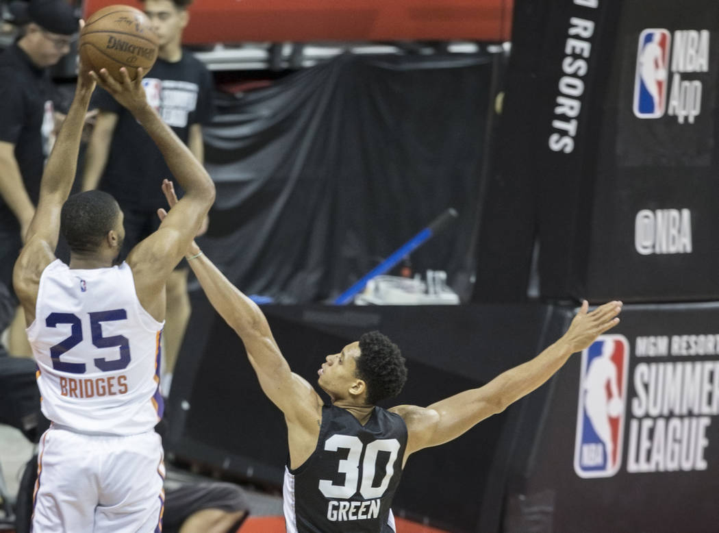 San Antonio Spurs guard Jordan Green (30) defends Phoenix Suns forward Mikal Bridges (25) in the third quarter during the NBA Summer League on Friday, July 13, 2018, at the Thomas & ...