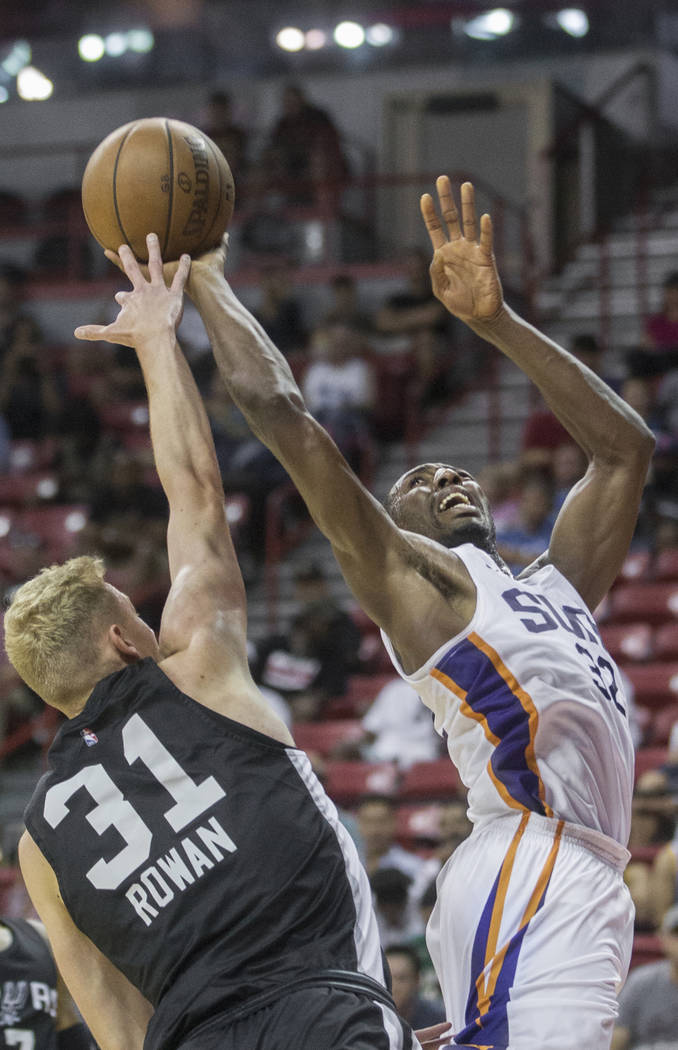 Phoenix Suns guard Devon Reed (32) shoots over San Antonio Spurs guard Maverick Rowan (31) in the second quarter during the NBA Summer League on Friday, July 13, 2018, at the Thomas &amp ...