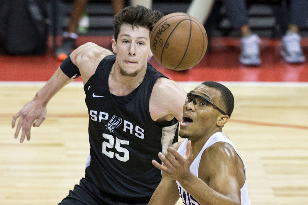 Phoenix Suns forward George King (8) fights for a rebound with San Antonio Spurs center Drew Ebanks (25) in the first quarter during theNBA Summer League on Friday, July 13, 2018, at the Tho ...