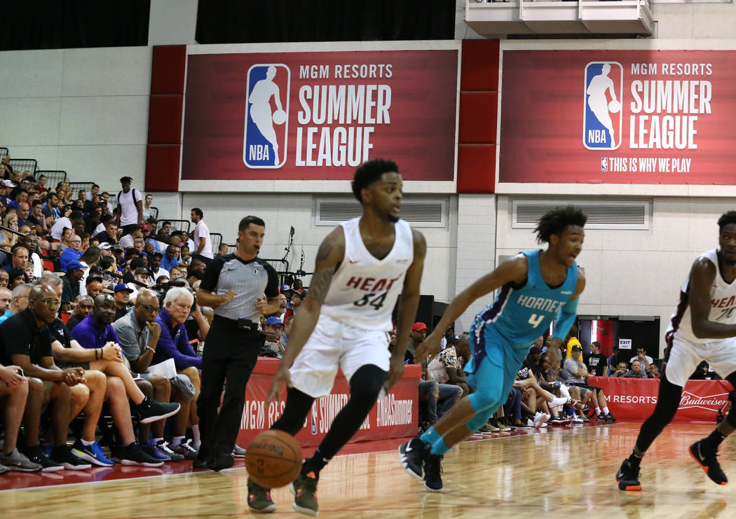 Fans watch an NBA Summer League basketball game between the Miami Heat and the Charlotte Hornets at the Cox Pavilion on Sunday, July 8, 2018, in Las Vegas. Bizuayehu Tesfaye/Las Vegas Review-Journ ...