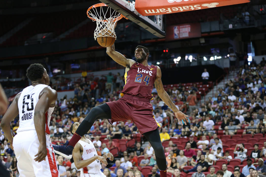 Cleveland Cavaliers' Marcus Lee (24) dunks the ball against the Houston Rockets during the NBA Summer League game at the Thomas & Mack Center in Las Vegas, Saturday, July 14, 2018. Erik Verduz ...