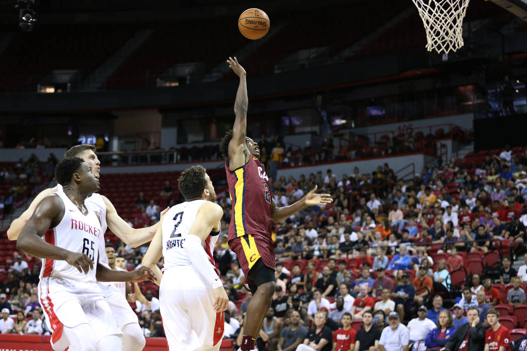 Cleveland Cavaliers' Collin Sexton (2) shoots the ball under pressure from Houston Rockets' Vincent Edwards (6) during the NBA Summer League game at the Thomas & Mack Center in Las Vegas, Satu ...