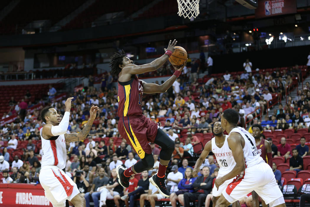 Cleveland Cavaliers' John Holland (10) takes a shot against the Houston Rockets during the NBA Summer League game at the Thomas & Mack Center in Las Vegas, Saturday, July 14, 2018. Erik Verduz ...