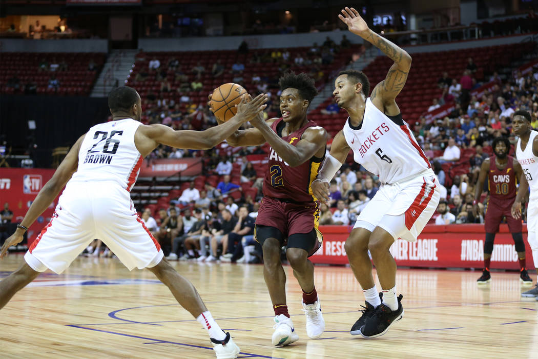 Cleveland Cavaliers' Collin Sexton (2) looks for an open pass under pressure from Houston Rockets' Markel Brown (26) and Vincent Edwards (6) during the NBA Summer League game at the Thomas & M ...