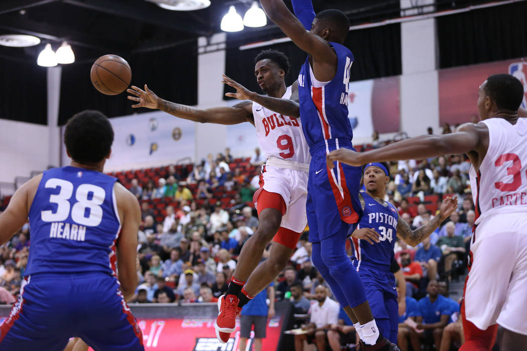 Chicago Bulls' Okaro White (9) makes a pass against Detroit PIstons' Johnny Hamilton (49) in the NBA Summer League game at Cox Pavilion in Las Vegas, Saturday, July 14, 2018. Erik Verduzco Las Veg ...