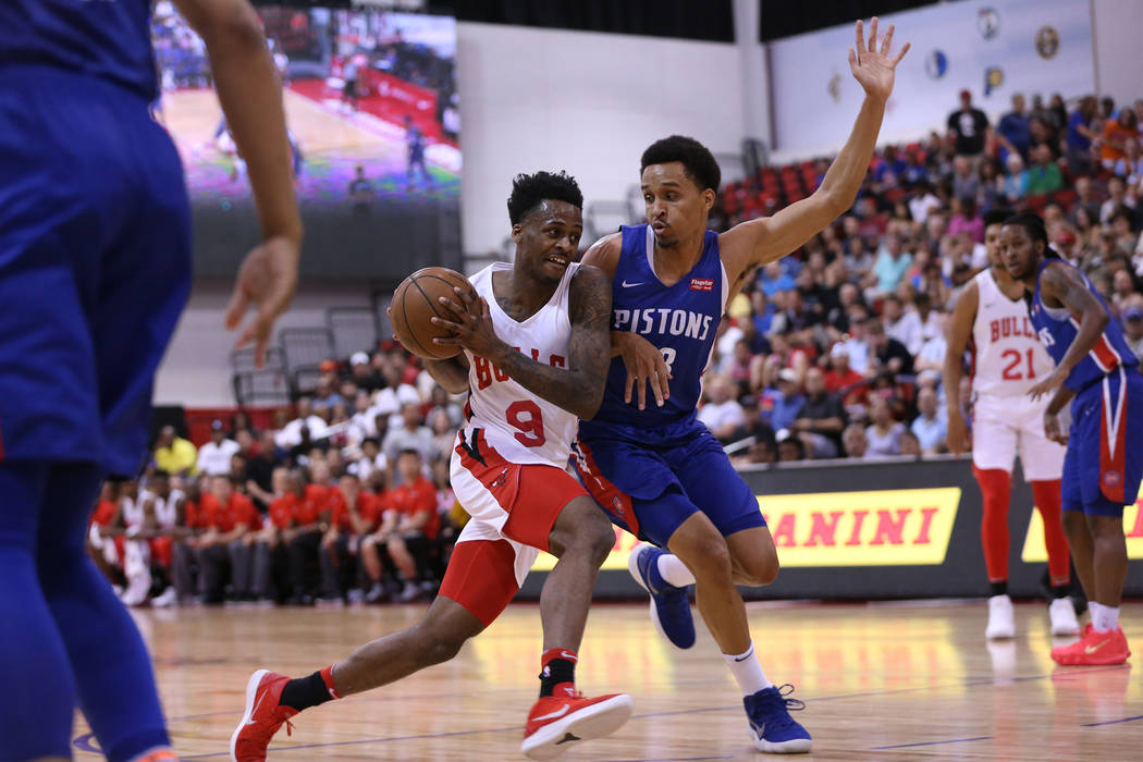 Chicago Bulls' Okaro White (9), drives the ball to the basket against pressure from Detroit Pistons' Reggie Hearn (38) in the NBA Summer League game at Cox Pavilion in Las Vegas, Saturday, July 14 ...
