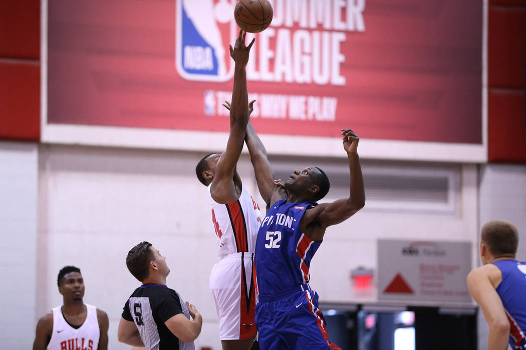 Chicago Bulls' Wendell Carter Jr. (34), and Detroit Pistons' Nnanna Egwu (52) jump for the ball at the start of the NBA Summer League game at Cox Pavilion in Las Vegas, Saturday, July 14, 2018. Er ...