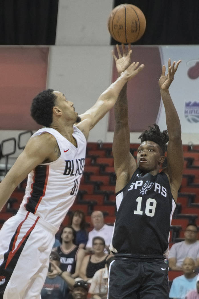 San Antonio Spurs guard Lonnie Walker (18) shoots over Portland Trail Blazers Wade Baldwin IV (2) in the 1st quarter during the NBA Summer League on Tuesday, July 10, 2018, at Cox Pavilion, in Las ...