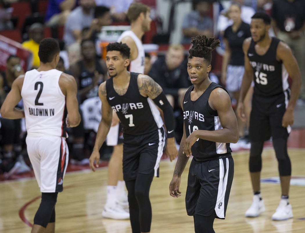 Spurs guard Lonnie Walker (18) plays defense in the 1st quarter during San Antonio's NBA Summer League game with the Portland Trail Blazers on Tuesday, July 10, 2018, at Cox Pavilion, in Las Vegas ...