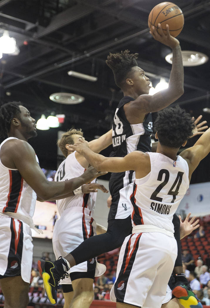 San Antonio Spurs guard Lonnie Walker (18) drives past Portland Trail Blazers Anfernee Simons (24) in the 2nd quarter during the NBA Summer League on Tuesday, July 10, 2018, at Cox Pavilion, in La ...