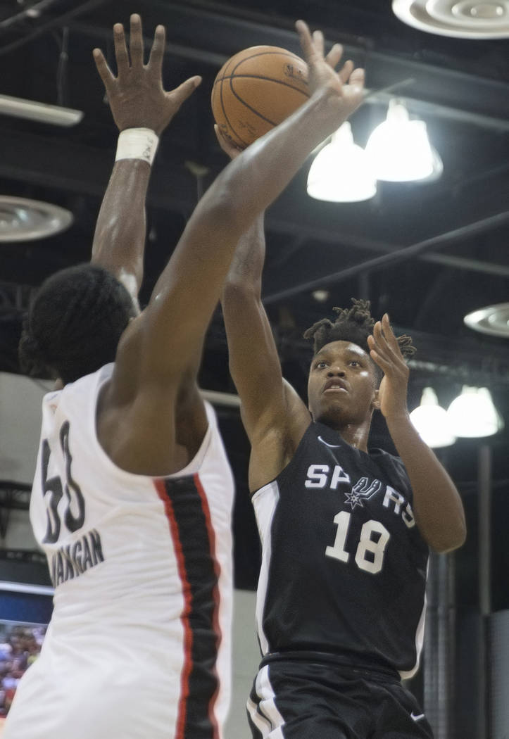 San Antonio Spurs guard Lonnie Walker (18) shoots over Portland Trail Blazers Caleb Swanigan (50) in the 2nd quarter during the NBA Summer League on Tuesday, July 10, 2018, at Cox Pavilion, in Las ...
