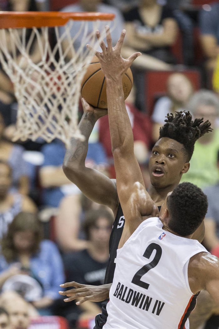 San Antonio Spurs guard Lonnie Walker (18) shoots over Portland Trail Blazers Wade Baldwin IV (2) in the 2nd quarter during the NBA Summer League on Tuesday, July 10, 2018, at Cox Pavilion, in Las ...