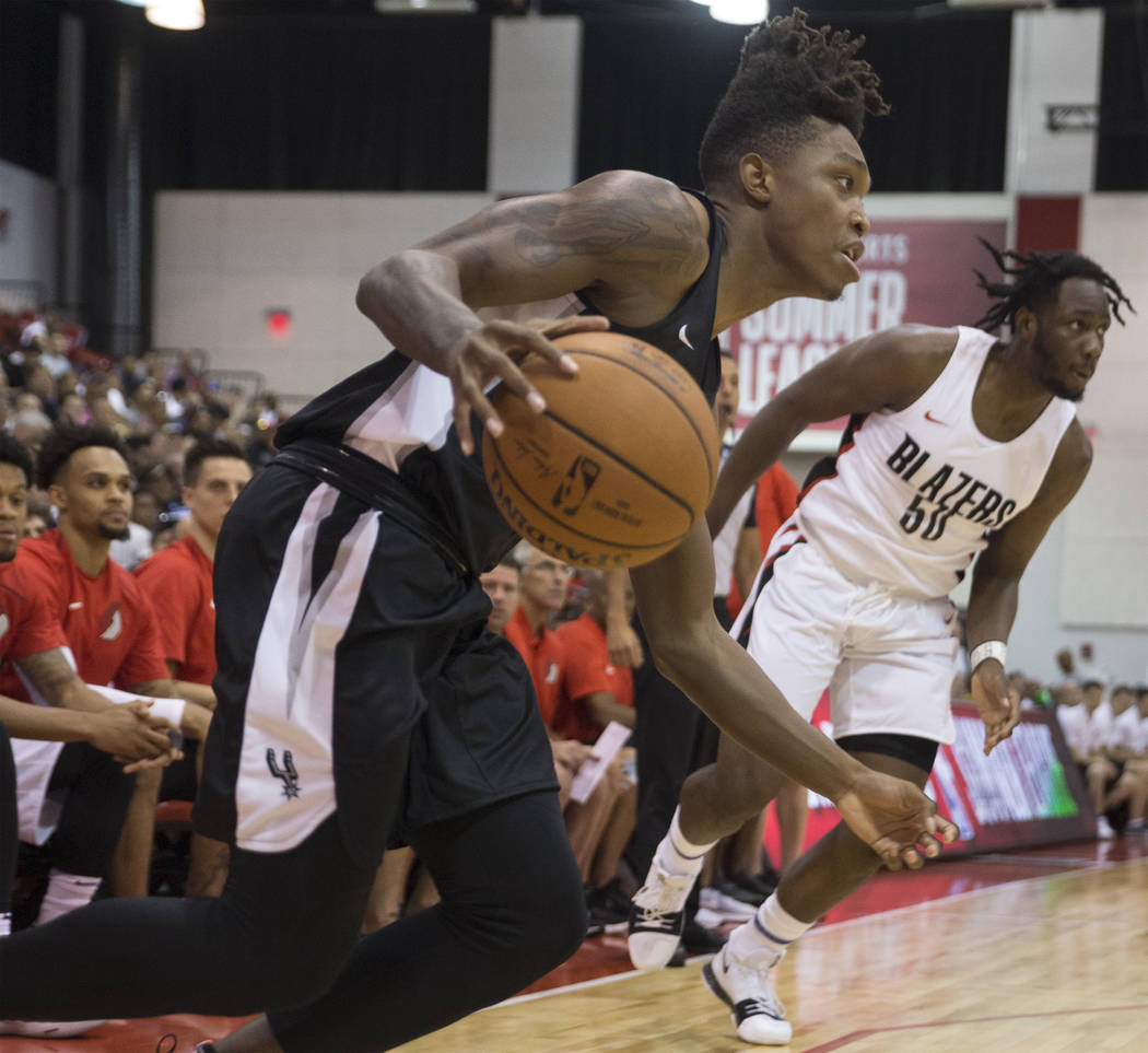 San Antonio Spurs guard Lonnie Walker (18) drives baseline past Portland Trail Blazers Caleb Swanigan (50) in the 2nd quarter during the NBA Summer League on Tuesday, July 10, 2018, at Cox Pavilio ...