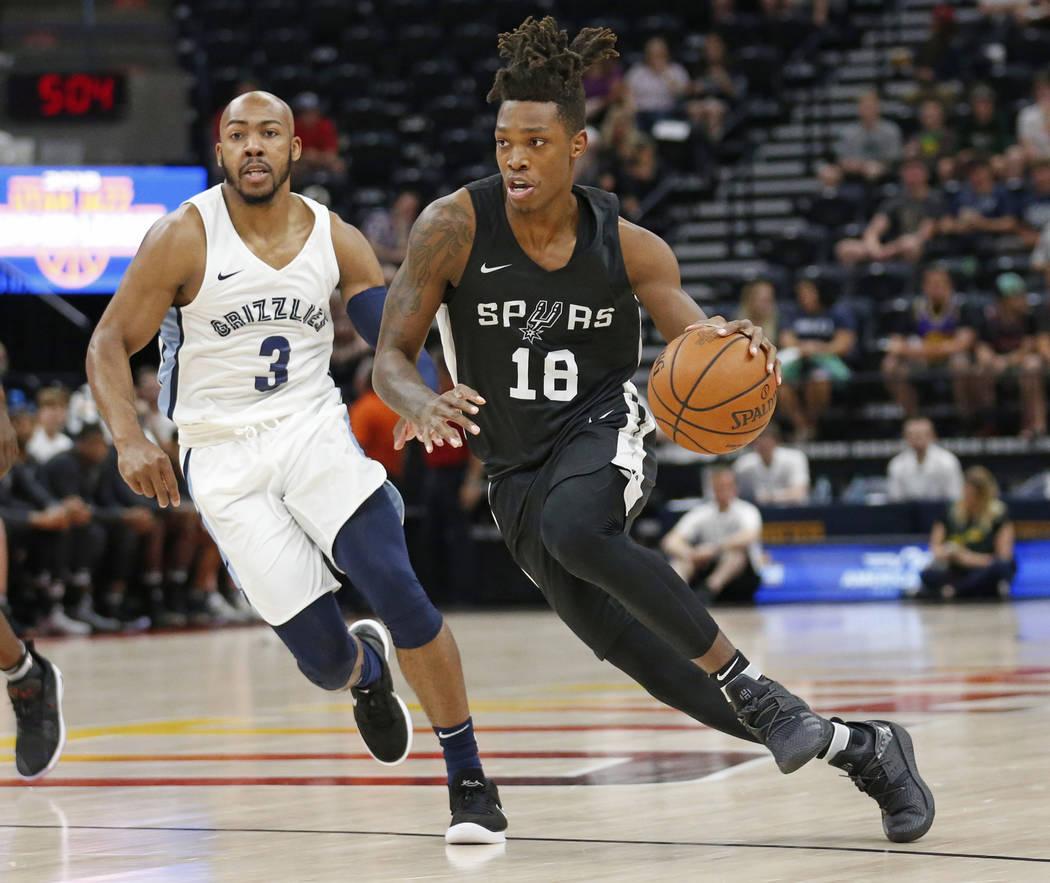 San Antonio Spurs guard Lonnie Walker IV (18) drives as Memphis Grizzlies guard Jevon Carter (3) trails during the first half of an NBA summer league basketball game Thursday, July 5, 2018, in Sal ...