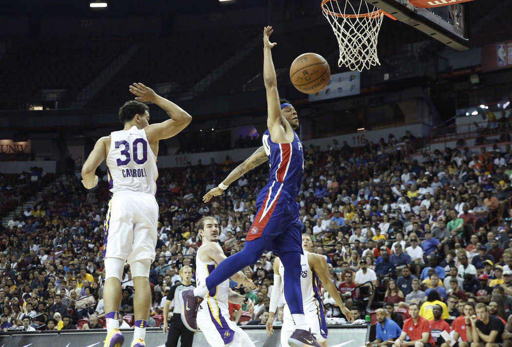 The Detroit Pistons guard Bruce Brown dunks as the Los Angeles Lakers Jeffrey Carroll guard (30) look on during an NBA Summer League basketball game at the Thomas and Mack Center on Sunday, July 1 ...