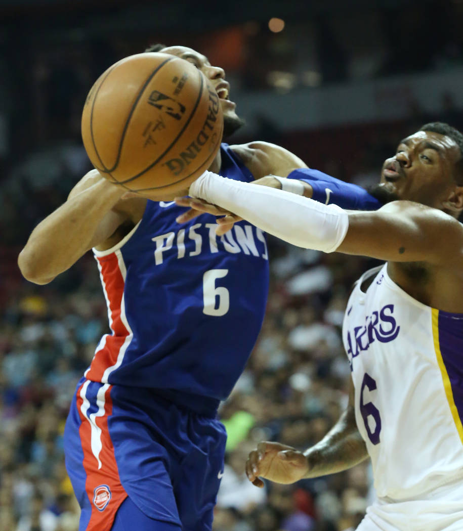 The Detroit Pistons guard Bruce Brown (6) is fouled by the Los Angeles Lakers guard Xavier Rathan-Mayes (6) during an NBA Summer League basketball game at the Thomas and Mack Center on Sunday, Jul ...
