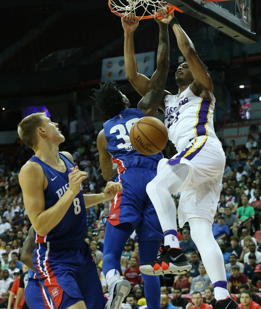 The Los Angeles Lakers forward Jonathan Williams, right, dunks against the Detroit pistons during an NBA Summer League basketball game at the Thomas and Mack Center on Sunday, July 15, 2018, in La ...
