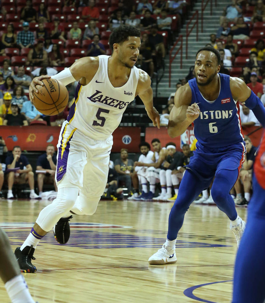 The Los Angeles Lakers guard Josh Hart (5) drives past the Detroit Pistons guard Bruce Brown (6) during an NBA Summer League basketball game at the Thomas and Mack Center on Sunday, July 15, 2018, ...