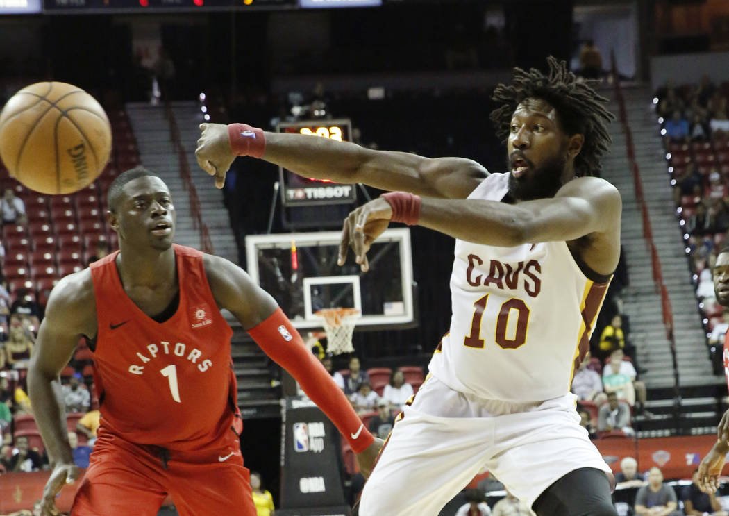The Cleveland Cavaliers guard John Holland (10) passes the ball as the Toronto Raptors guard Rawle Alkins (1) looks on during an NBA Summer League basketball game at the Thomas and Mack Center on ...