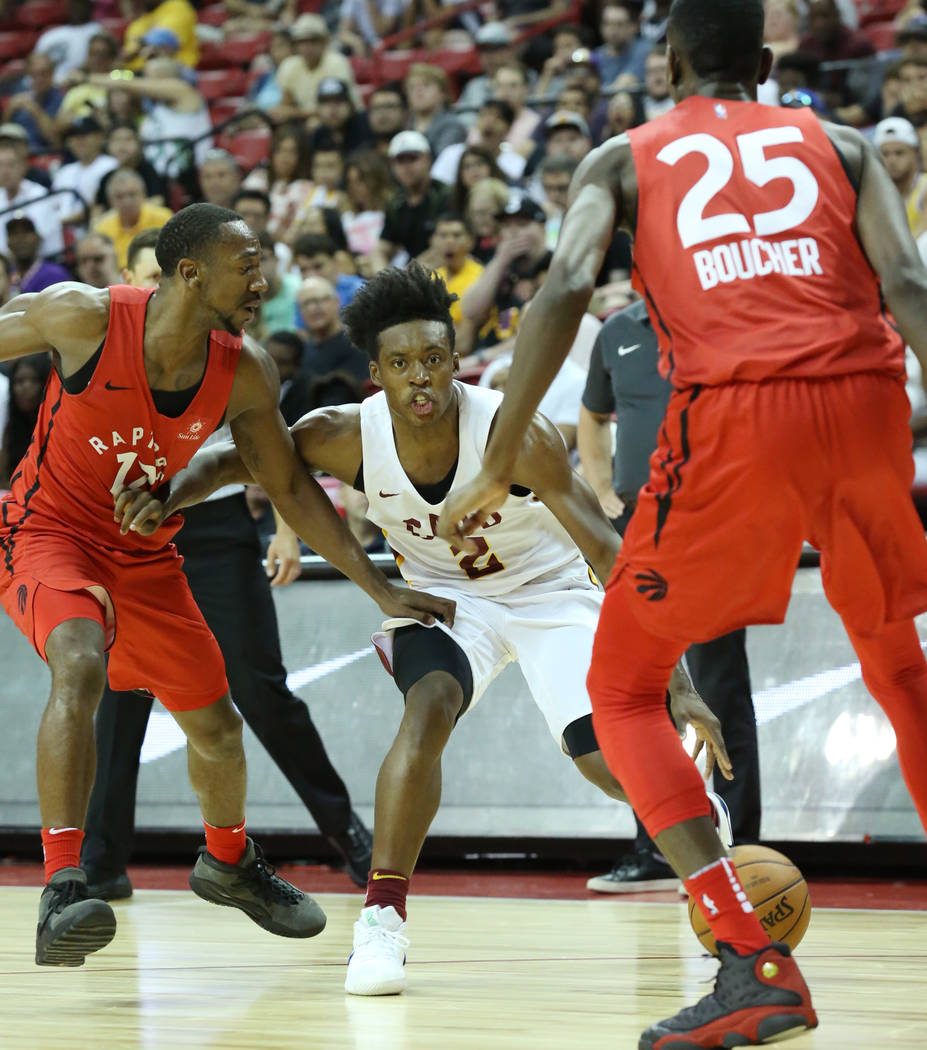The Cleveland Cavaliers guard Collin Sexton (2) defended by the Toronto Raptors forward Chris Boucher (25) and guard Rawle Alkins (1) during an NBA Summer League basketball game at the Thomas and ...
