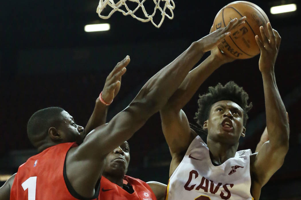 The Cleveland Cavaliers guard Collin Sexton (2) shoots around the Toronto Raptors forward Chris Boucher (25) and guard Rawle Alkins (1) during an NBA Summer League basketball game at the Thomas a ...