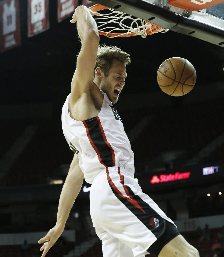 The Portland Trail Blazers forward Jake Layman (10) dunks against the Boston Celtics during an NBA Summer League basketball game at the Thomas and Mack Center on Sunday, July 15, 2018, in Las Vega ...