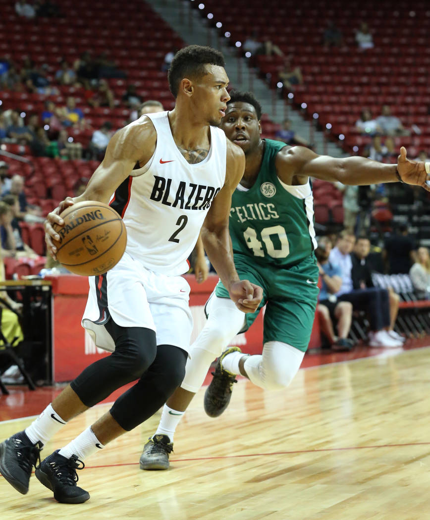 The Portland Trail Blazers guard Wade Baldwin IV (2) drives past the Boston Celtics Justin Bibbs during an NBA Summer League basketball game at the Thomas and Mack Center on Sunday, July 15, 2018, ...