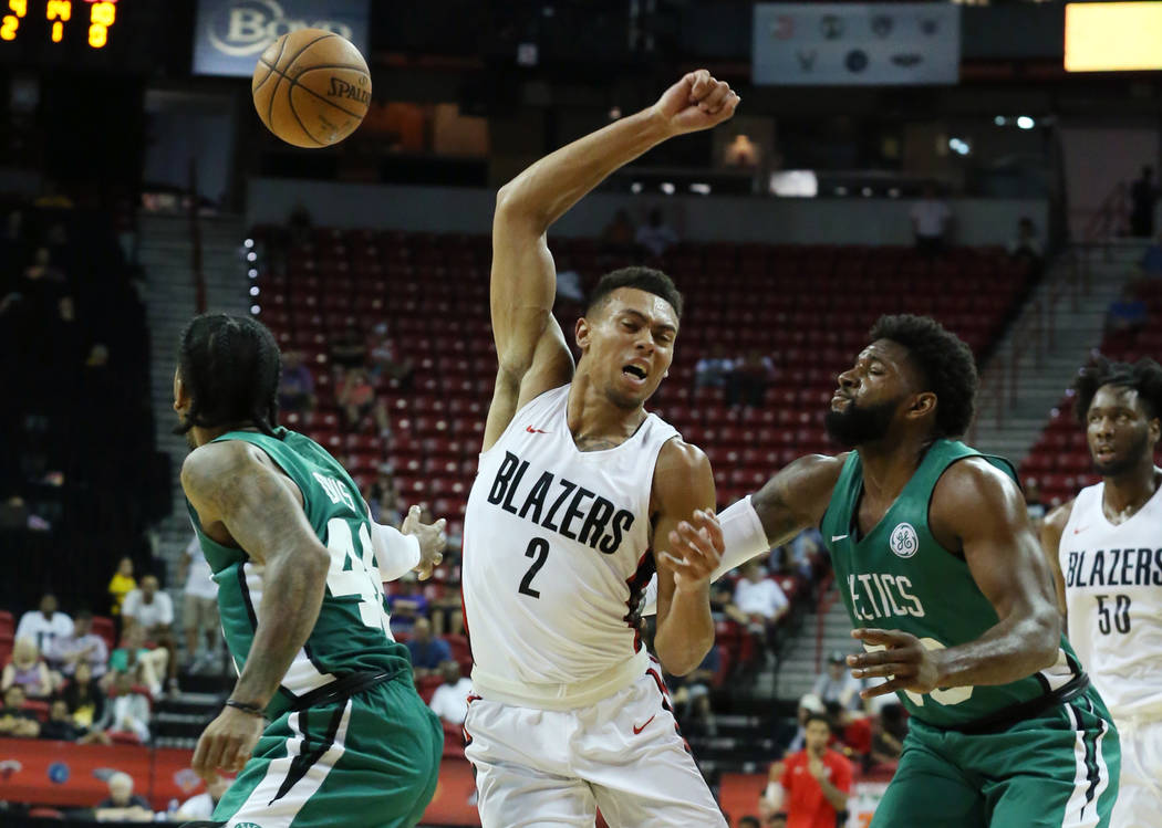 The Portland Trail Blazers guard Wade Baldwin IV (2) looses the ball as he tries to drive past the Boston Celtics Trey Davis (48) and Hassan Martin (63) during an NBA Summer League basketball game ...