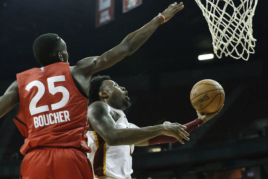 The Cleveland Cavaliers forward Jamel Artis, right, shoots around the Toronto Raptors forward Chris Boucher (25) during an NBA Summer League basketball game at the Thomas and Mack Center on Sunday ...