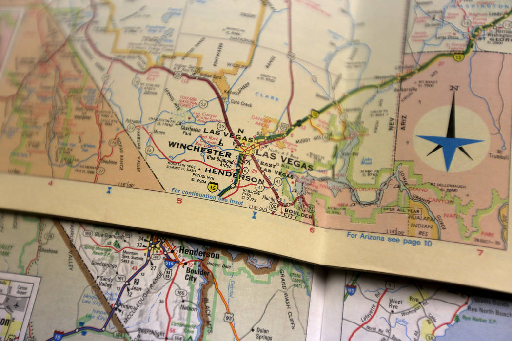 Old versions of Sate Farm Road Atlases, one from 1962 and one from 1968, at the Clark County Museum in Henderson on Monday, June 25, 2018. Hall-Patton is the Museum Administrator for the Clark Cou ...