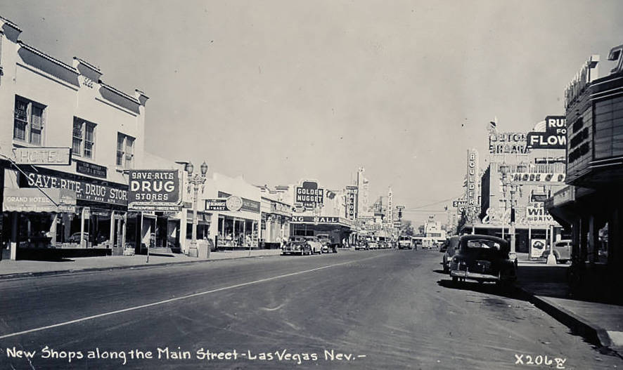"Photograph of shops on Fremont Street, Las Vegas (Nev.), 1930s Description Fremont Street postcard, Las Vegas Nevada. Text at the bottom reads: ""New shops along the Main Street-Las Vegas, Nev."" S ..."