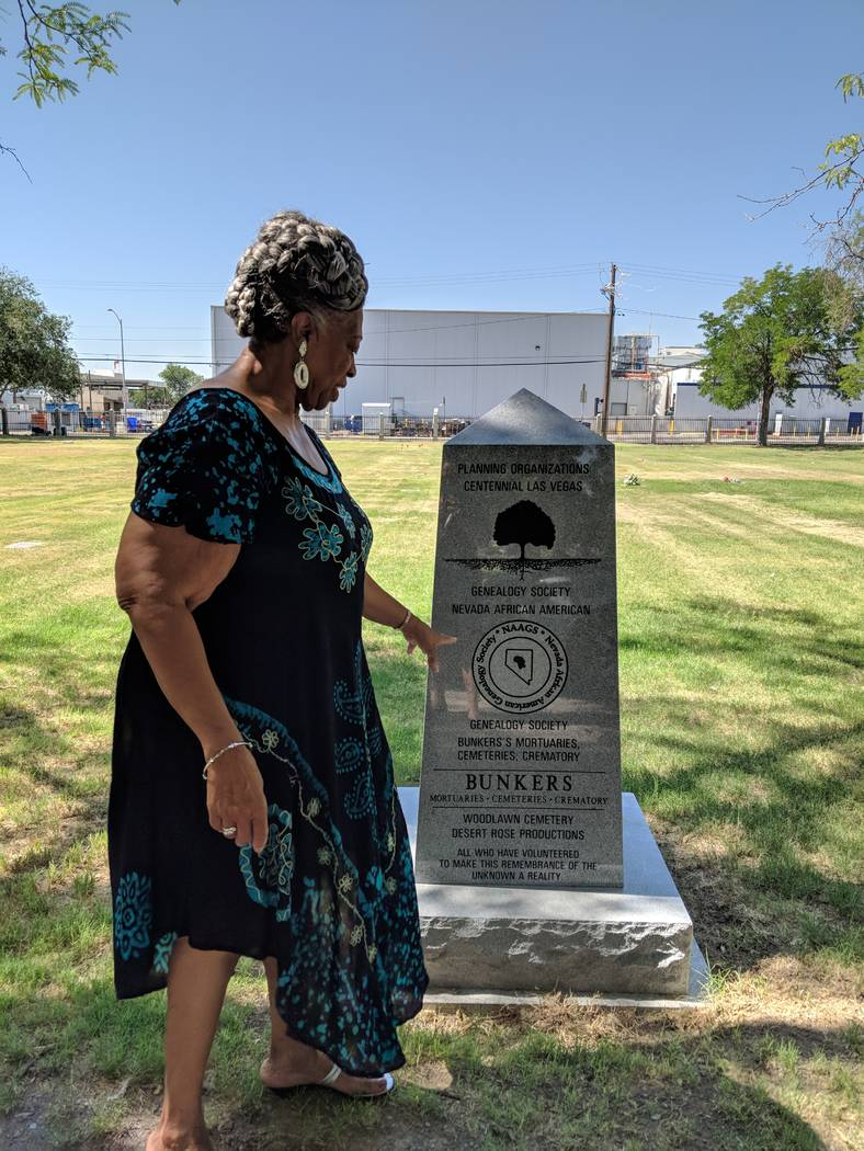 Nevada African American Genealogy Society President and Founder Darell White points to a new marker in Las Vegas' Woodlawn Cemetery that memorializes people who are buried in unmarked graves on Tu ...