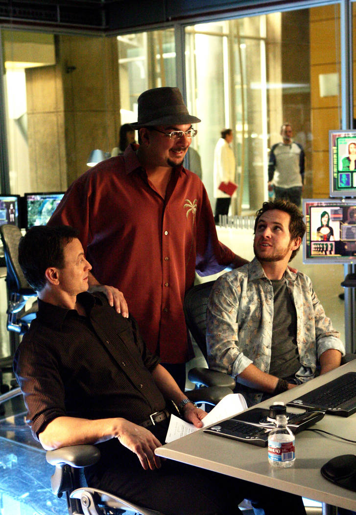 """Anthony Zuiker flanked by series stars Gary Sinise and A.J. Buckley on the set of """"CSI: NY"""" in 2007. (Monty Brinton/CBS)"""