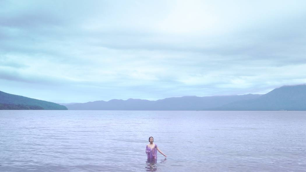 """A film still from """"Across the Water"""" by Nao Yoshigai, featured in Bellagio Gallery of Fine Arts' """"Primal Water."""""""