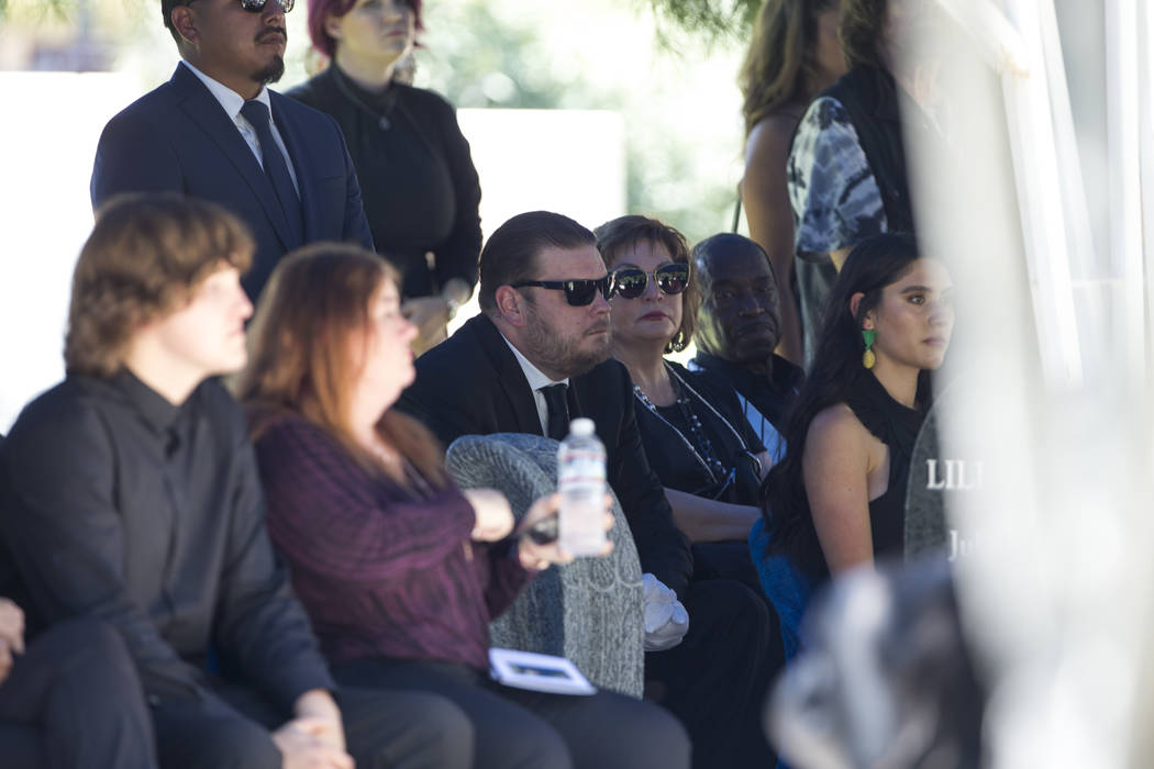 """Reality television personality Corey Harrison, center, is surrounded by friends and family as he attends the funeral service of his grandfather, """"Pawn Stars"""" patriarch, Richard Benjamin ..."""