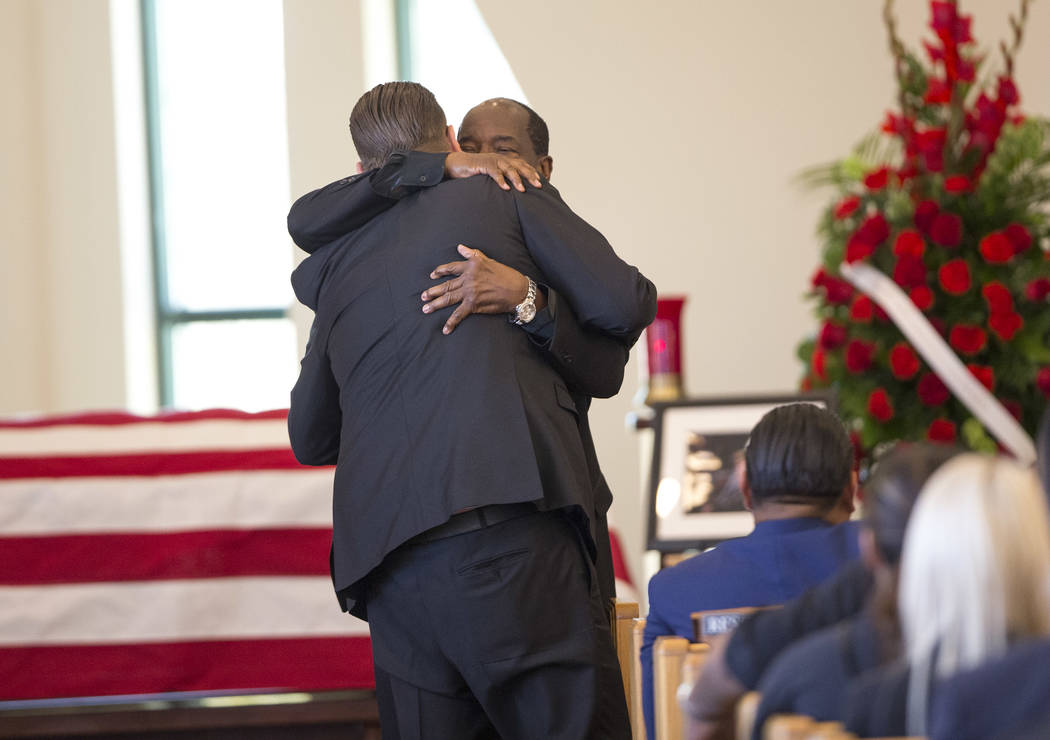 """Reality television personality Cory Harrison, left, and Charlie Duncan hug after Duncan spoke at the funeral service of Harrison's grandfather, """"Pawn Stars"""" patriarch, Richard Benjamin H ..."""