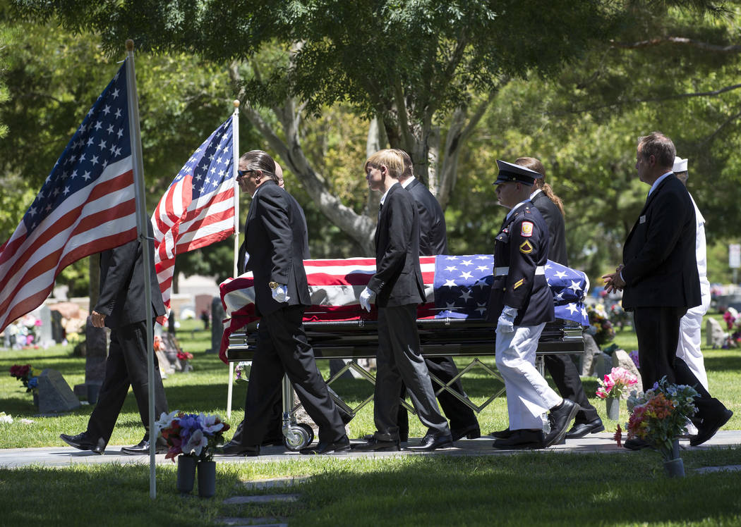 """Pallbearers walk alongside the casket of """"Pawn Stars"""" patriarch, Richard Benjamin Harrison, known as """"The Old Man,"""" at his funeral service at Palm Northwest Mortuary in Las Veg ..."""
