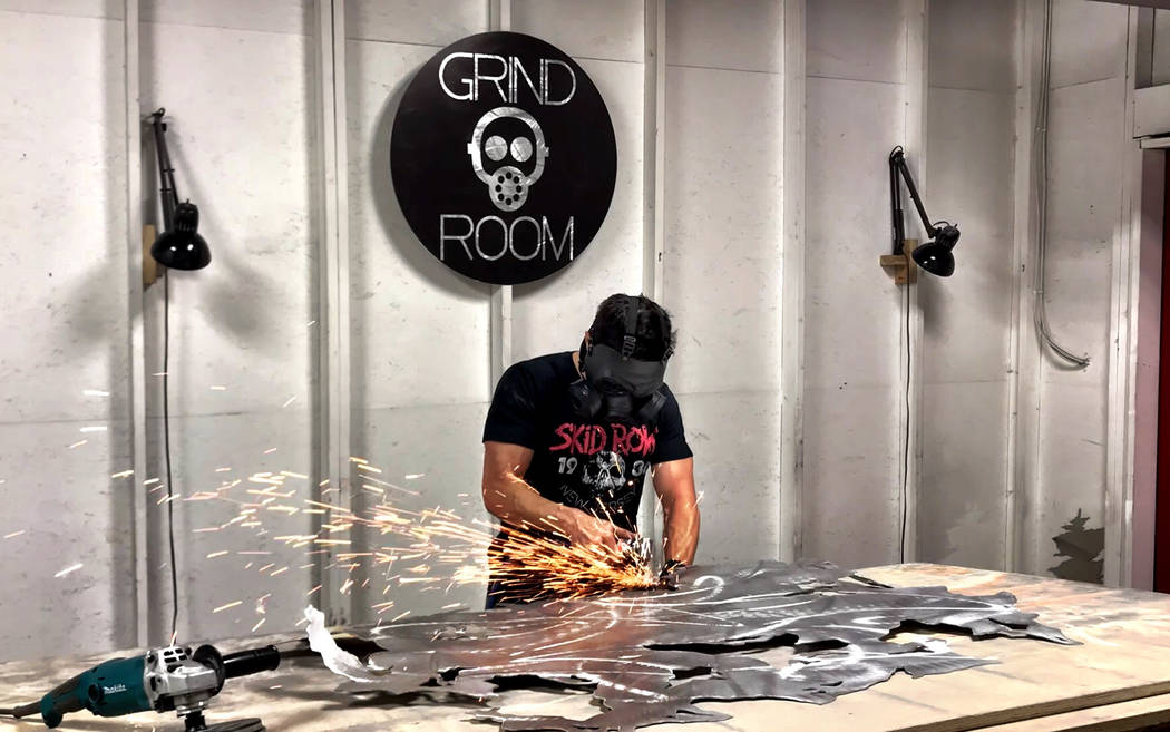 """Cincinnati-based metal artist Nicholas Yust at work in his """"grinding room."""""""