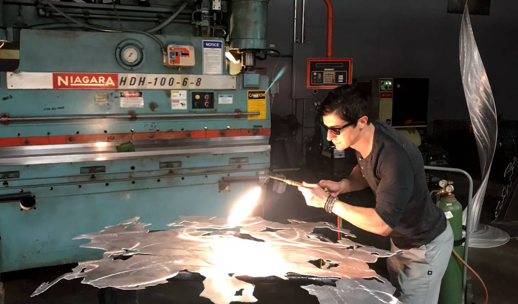 Metal artist Nicholas Yust at work.