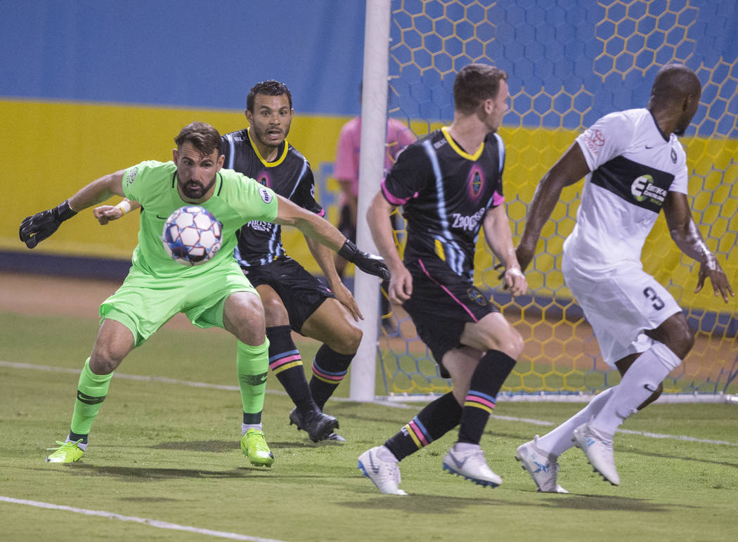 Saint Louis FC goalkeeper Tomás Gómez (1) makes a save against Las Vegas Lights FC forward Samuel Ochoa (9) and midfielder James Murphy (19) in the first half on Saturday, July 7, 2018, ...