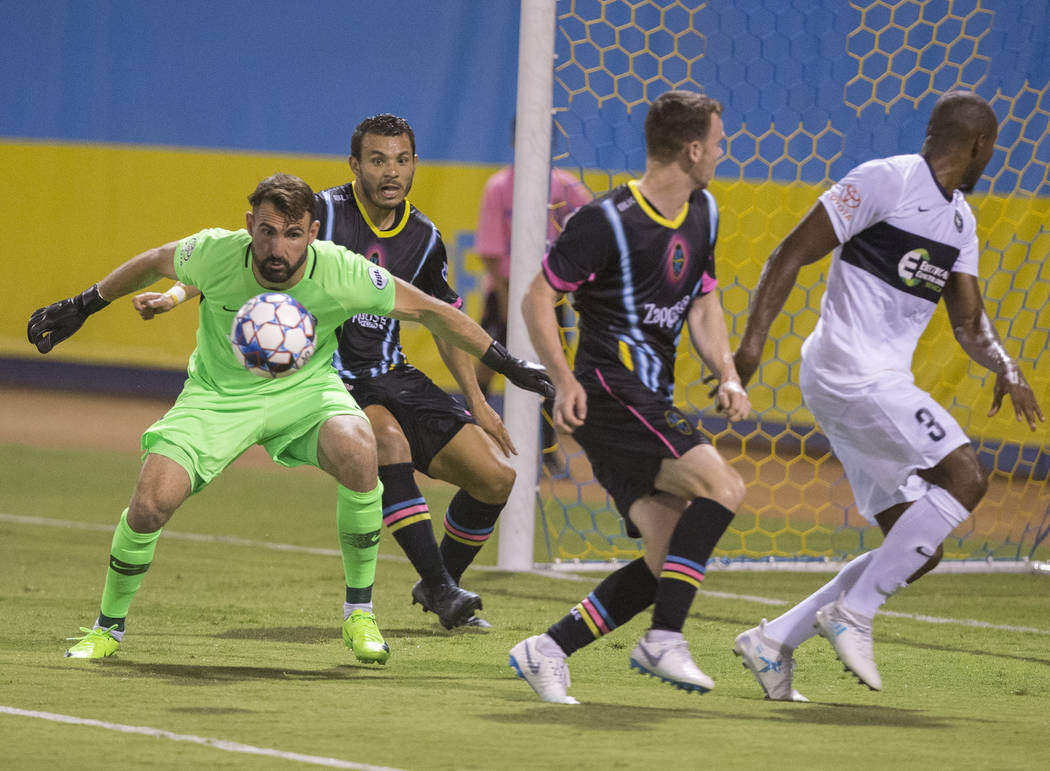 Saint Louis FC goalkeeper Tom‡s G—mez (1) makes a save against Las Vegas Lights FC forward Samuel Ochoa (9) and midfielder James Murphy (19) in the first half on Saturday, July 7, 20 ...