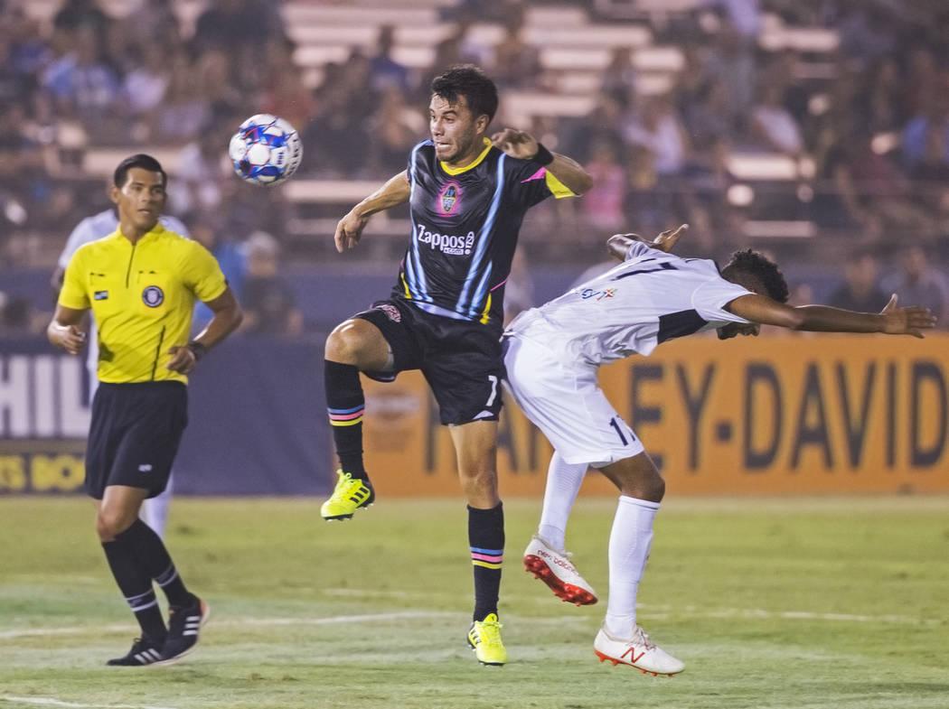 Las Vegas Lights FC midfielder Carlos Alvarez (7) fights for a loose ball with Saint Louis FC midfielder Wal Fall (17) in the first half on Saturday, July 7, 2018, at Cashman Field, in Las Vegas. ...