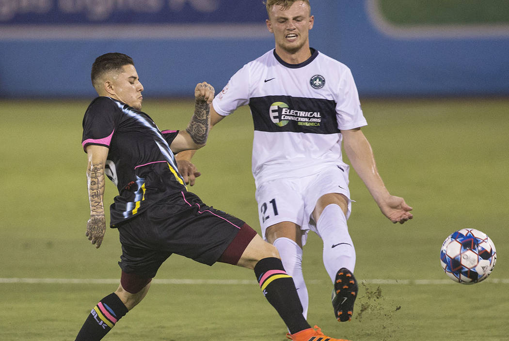 Las Vegas Lights FC forward Raul Mendiola (40) fights for a ball with Saint Louis FC defender Aeden Stanley (21) in the first half on Saturday, July 7, 2018, at Cashman Field, in Las Vegas. (Benja ...