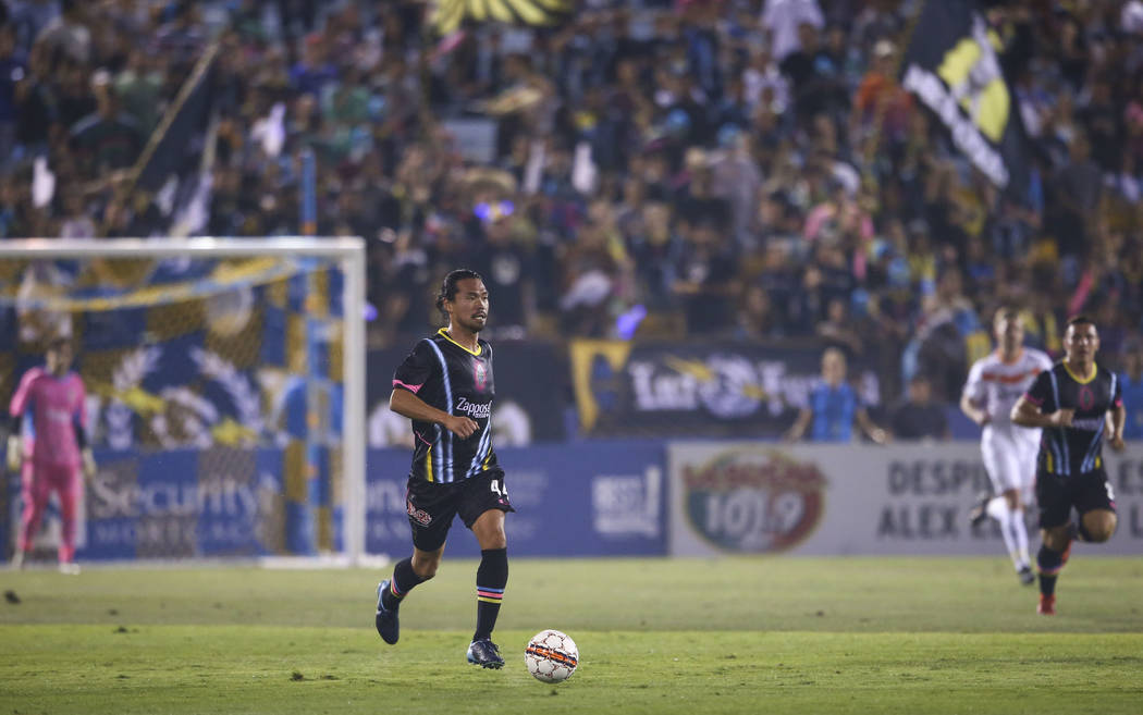Las Vegas Lights FC midfielder Daigo Kobayashi (44) moves the ball during the first half of a United Soccer League game against the Tulsa Roughnecks FC at Cashman Field in Las Vegas on Saturday, ...