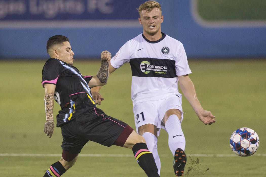 Las Vegas Lights FC forward Raul Mendiola (40) fights for a ball with Saint Louis FC defender Aeden Stanley (21) in the first half on Saturday, July 7, 2018, at Cashman Field, in Las Vegas. Benjam ...