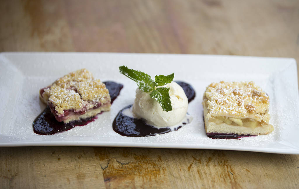The Red, White and Blue dessert combo, a scoop of vanilla ice cream flanked by homemade cherry and apple pies served on a bed of blueberry compote at Hofbrauhaus Las Vegas on Friday, June 29, 2018 ...
