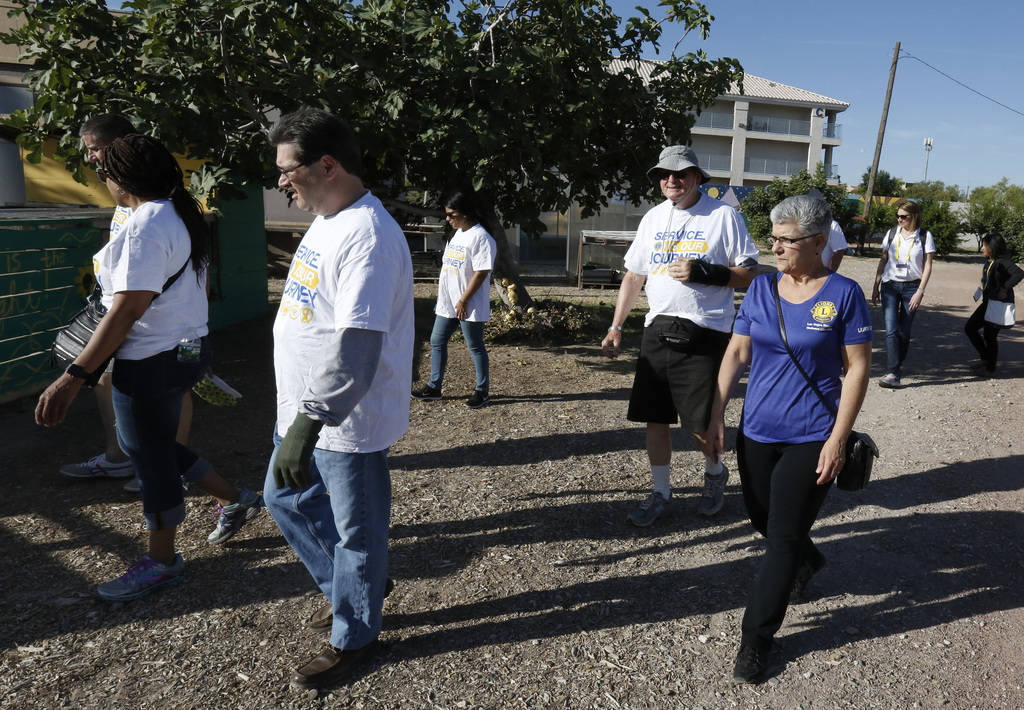 Dr. Denise Tropea, right, joins members of Lion's International during a tour of Vegas Roots Community Garden on Friday, June 29, 2018, in Las Vegas. Bizuayehu Tesfaye/Las Vegas Review-Journal @bi ...
