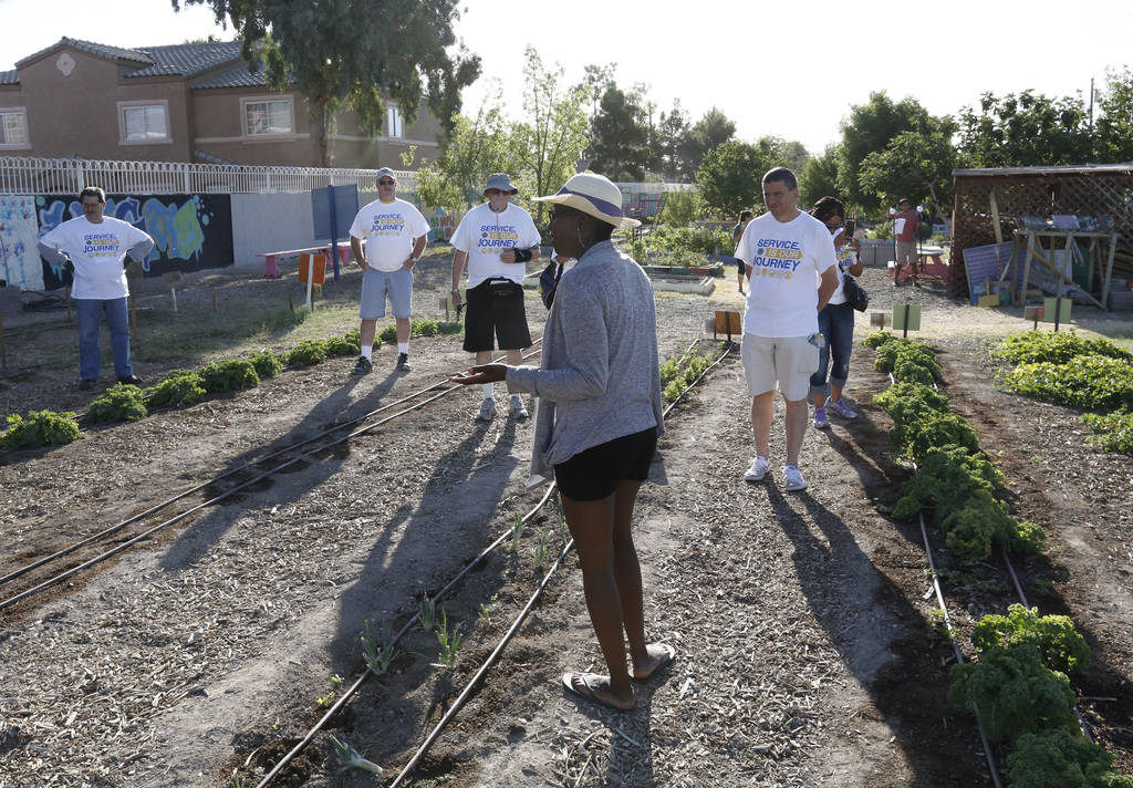 Cheyenne Kyle, program coordinator at Vegas Roots, leads a tour of Vegas Roots Community Garden to members of Lion's International on Friday, June 29, 2018, in Las Vegas. Bizuayehu Tesfaye/Las Veg ...